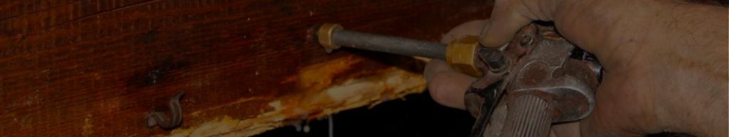 Mise en place d'un traitement préventif de charpente